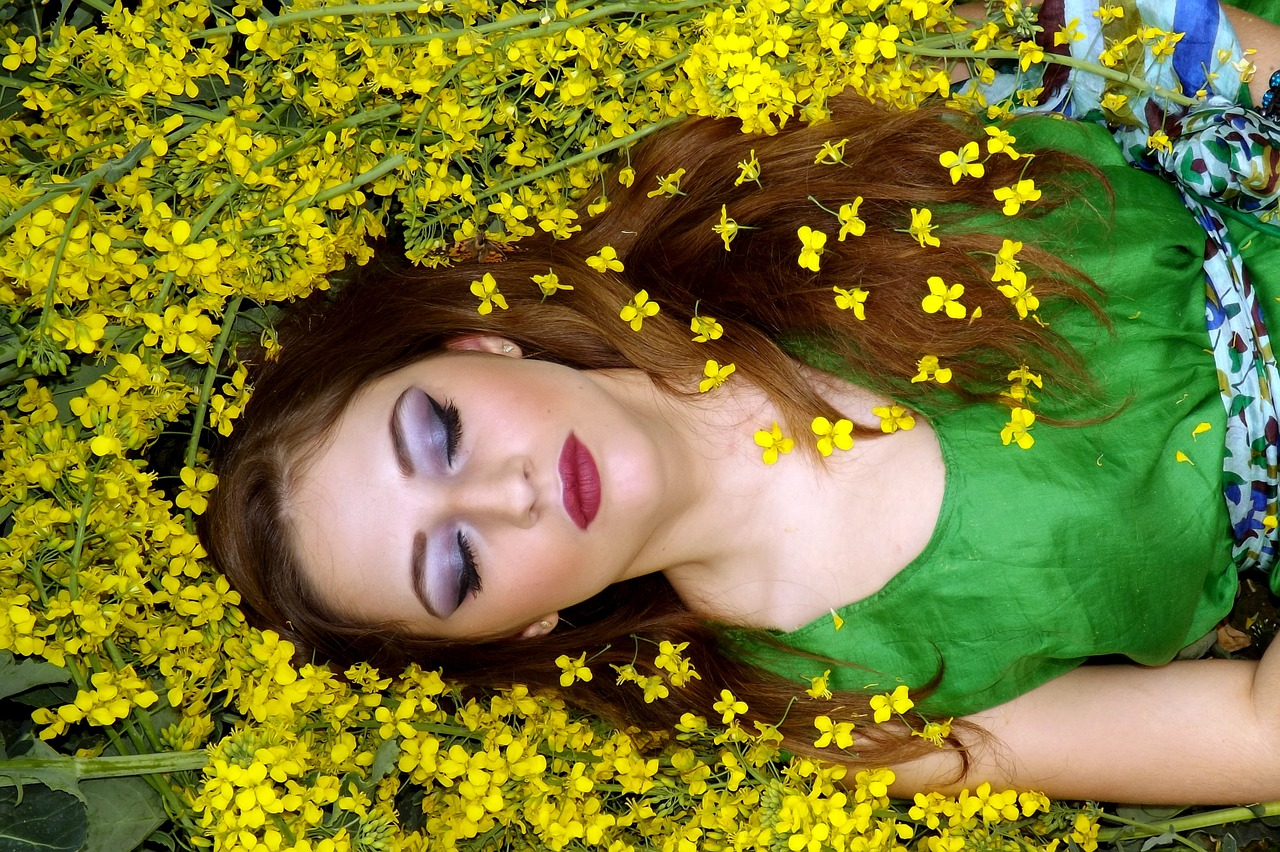 Woman dreaming in field of flowers